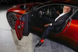 Portrait Heiner Pohl, Köln. Inhaber und Geschäftsführer von Pohl Fassades mit einem Aston Martin DB 11